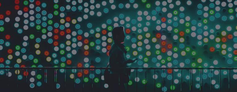 man standing in front of colourful array of lights at night showing energy resilience 24 7